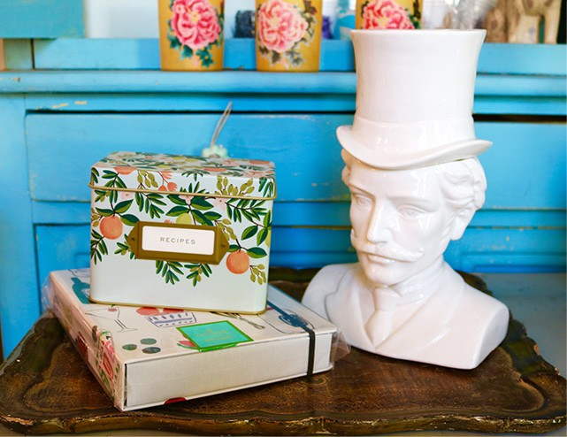 A top hat bust next to literature.